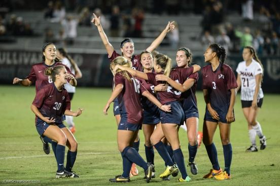 LMU women's soccer vs. Nebraska-Omaha Maddie Medved Game Winning Penalty Kick celebrates with Team