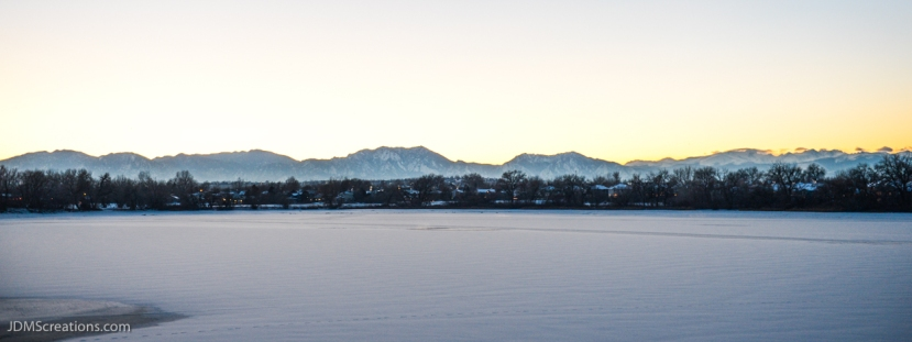 The Rocky Mountains on a 10-degree dusk behind Waneka Lake in Lafayette Colorado Dec. 18, 2016