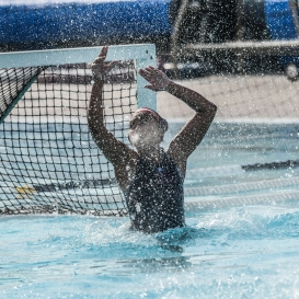 Sky Flores in morning fog as water sprays from hitting the post LMU women's water polo vs. Michigan LMU Invitational Mar. 17, 2027