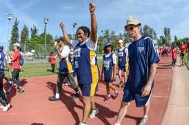 Special Olympics Southern California LA/SGV Pomona Area Games April 22, 2017 Westside athlete smiling with arms raised