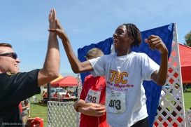 Special Olympics Southern California LA/SGV Pomona Area Games April 22, 2017 USC athlete high-fives Azusa Sheriff