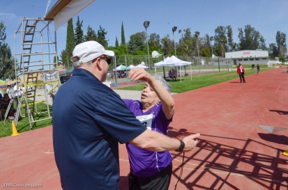 Special Olympics Southern California LA/SGV Pomona Area Games April 22, 2017 Pomona Valley walker athlete Tania D'Amore finishes race into the arms of a volunteer coach