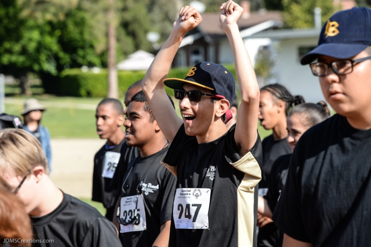 Special Olympics Southern California LA/SGV Pomona Area Games April 22, 2017 Long Beach athlete Joshua Sanchez sprinter, smile hands up celebration
