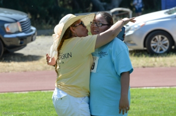 Special Olympics Southern California LA/SGV Pomona Area Games April 22, 2017 mom celebrates with San Gabriel Valley daughter after softball throw hug and kiss