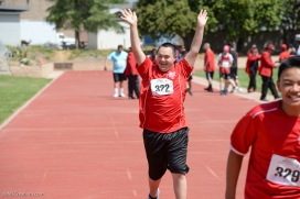 Special Olympics Southern California LA/SGV Pomona Area Games April 22, 2017 Norwalk athlete is so excited during race, he turns to celebrate with crowd