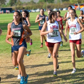 Danielle Shanahan (198) confirms strategy with Madelyn Vorgitch (199) as the pack thins out and leaders pull away. LMU Cross Country at Mark Covert Classic - Brea, CA - Carbon Canyon Regional Park - Sept. 2, 2017