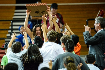 Cheerleader is crushed by kids for pizza during Tower Pizza Yell as President Tim Snyder takes a snap shot on his phone. LMU women's basketball vs. BYU Jan. 18, 2018 - Education Day